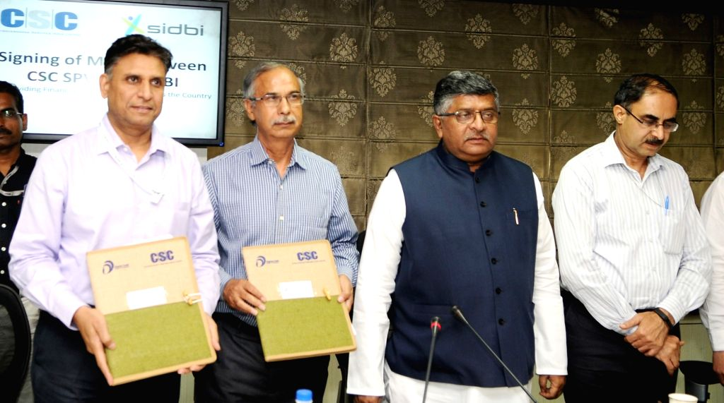 Union Electronics and Information Technology Minister Ravi Shankar Prasad addresses at the signing ceremony of an MoU for providing financial assistance to expand and strengthen ... - Ravi Shankar Prasad