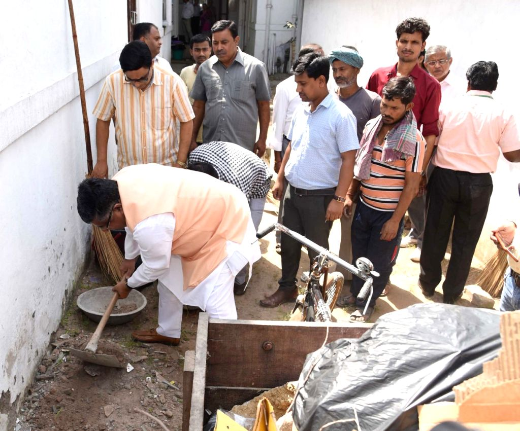 """Union Electronics and Information Technology and Law and Justice Minister Ravi Shankar Prasad participates in a cleanliness drive, organised as part of the """"Swachhata Hi Seva"""" ... - Ravi Shankar Prasad"""