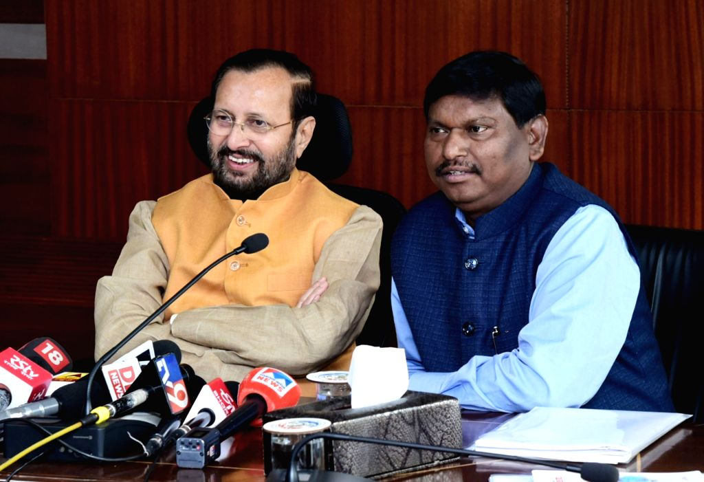 Union Environment, Forest and Climate Change, Information and Broadcasting and Heavy Industries and Public Enterprise Minister Prakash Javadekar accompanied by Union Tribal Affairs ... - Prakash Javadekar and Arjun Munda