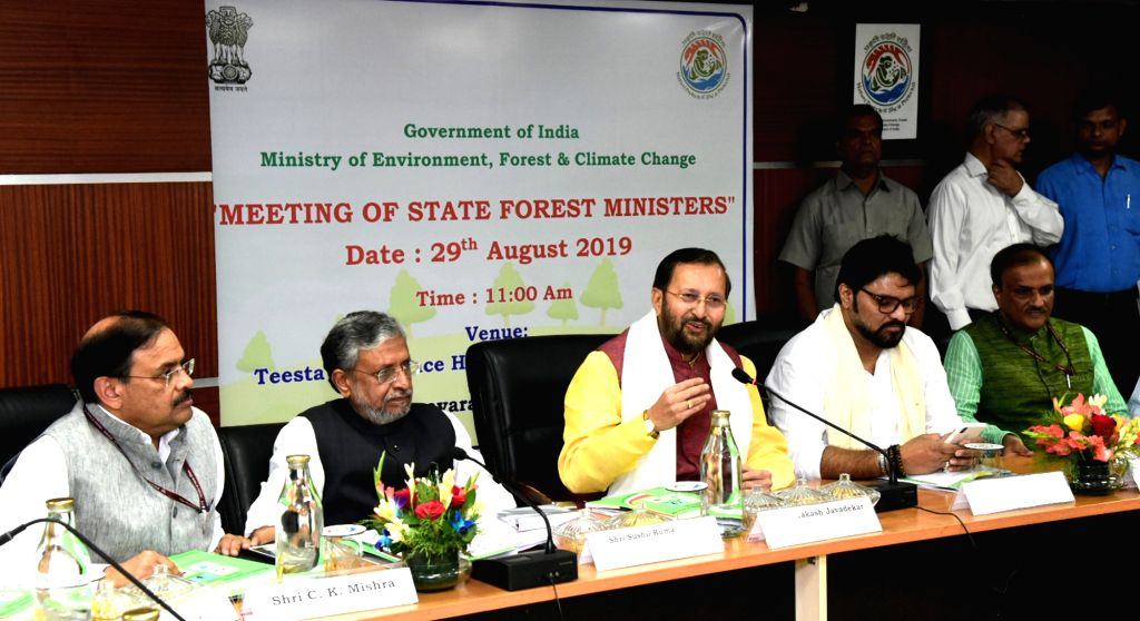 Union Environment, Forest and Climate Change and Information and Broadcasting Minister Prakash Javadekar chairs the Meeting of the State Forest Ministers, in New Delhi on Aug 29, 2019. ... - Prakash Javadekar and K. Mishra