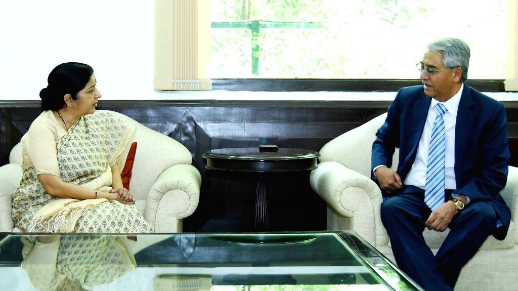 Union External Affairs Minister Sushma Swaraj meets Sher Bahadur Deuba, President of Nepali Congress in New Delhi on April 21, 2016. - Sushma Swaraj