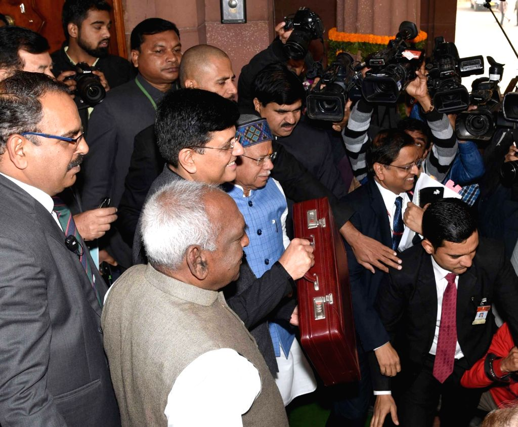Union Finance and Corporate Affairs Minister Piyush Goyal accompanied by Union Ministers of State for Finance Pon Radhakrishnan and Shiv Pratap Shukla, arrives at Parliament to present the ... - Piyush Goyal