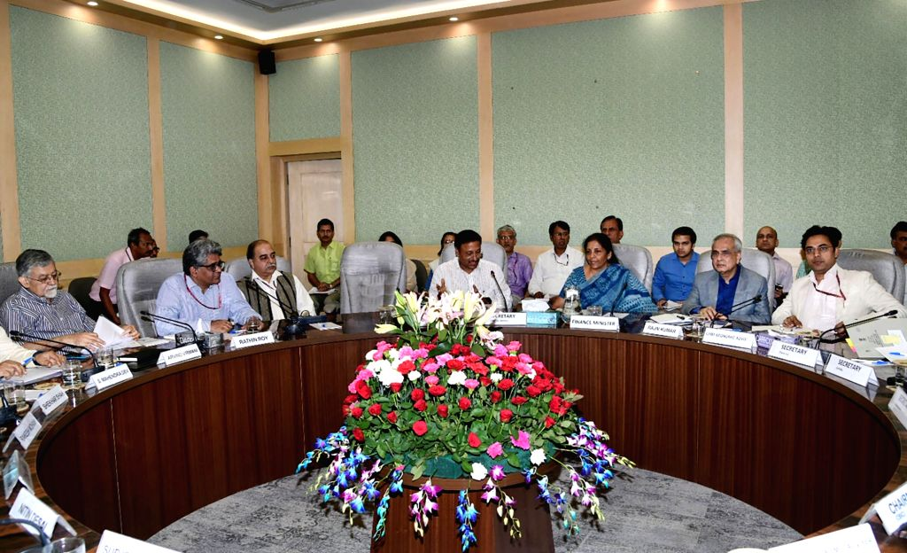 Union Finance and Corporate Affairs Minister Nirmala Sitharaman chairs the Pre-Budget consultations with Economists, in New Delhi on June 14, 2019. Also seen  NITI Aayog Vice-Chairman ... - Nirmala Sitharaman and Rajiv Kumar
