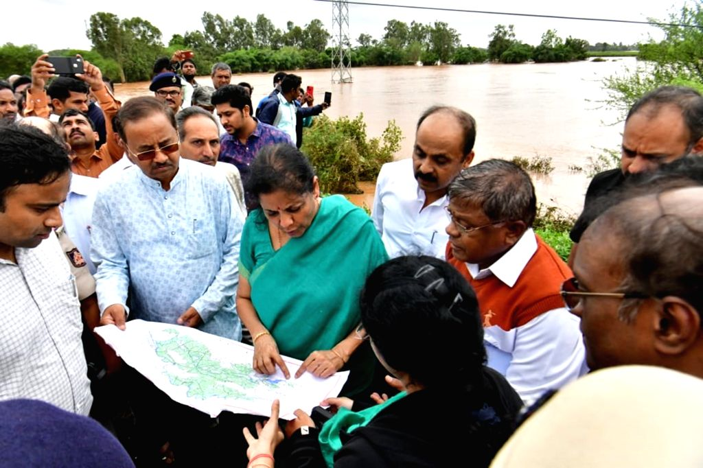Union Finance and Corporate Affairs Minister Nirmala Sithraman during her visit to the flood affected areas near Markhandaya River in Karnataka's Belagavi on Aug 10, 2019. - Nirmala Sithraman