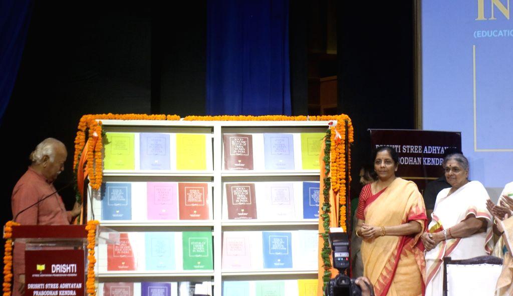 Union Finance and Corporate Affairs Minister Nirmala Sitharaman and Rashtriya Swayamsevak Sangh (RSS) chief Mohan Bhagwat unveil report on Status of Women in India, in New Delhi on Sep 24, ... - Nirmala Sitharaman