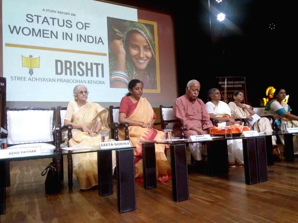 Union Finance and Corporate Affairs Minister Nirmala Sitharaman and Rashtriya Swayamsevak Sangh (RSS) chief Mohan Bhagwat at the launch of a report by RSS-backed study on women across ... - Nirmala Sitharaman