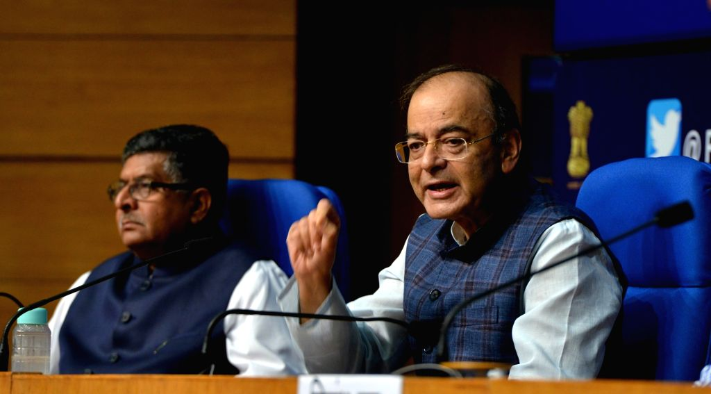 Union Finance and Corporate Affairs Minister Arun Jaitley addresses during a press conference after a cabinet briefing, along with Union Electronics and Information Technology and Law and ... - Arun Jaitley and Alok Verma