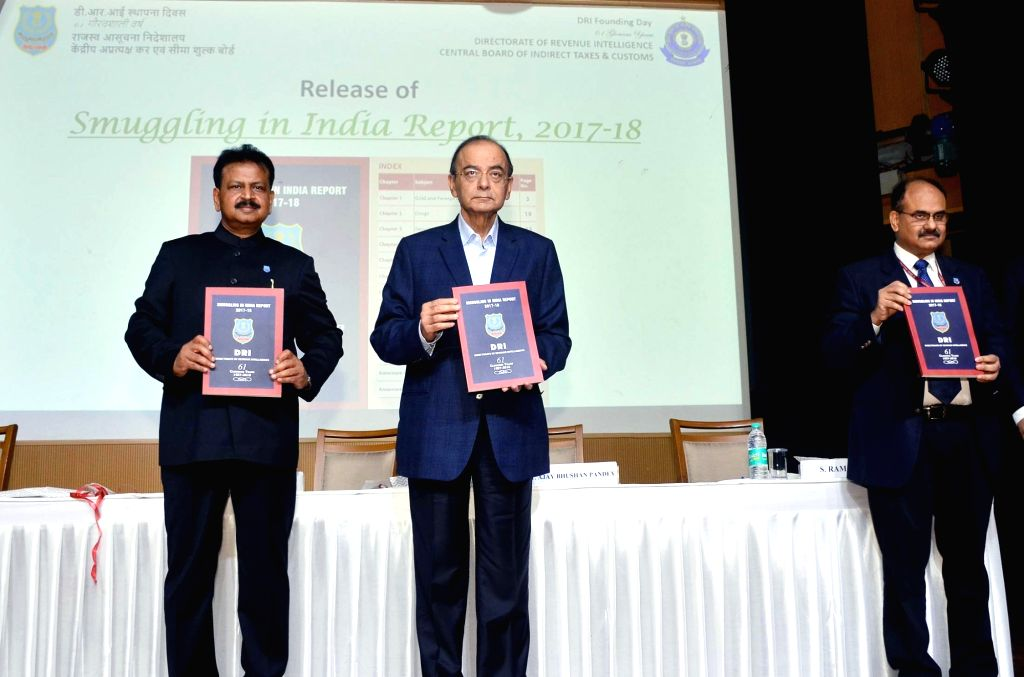 Union Finance and Corporate Affairs Minister Arun Jaitley accompanied by Revenue Secretary Ajay Bhushan Pandey and Directorate of Revenue Intelligence (DRI) DG D.P. Dash releases the ... - Arun Jaitley