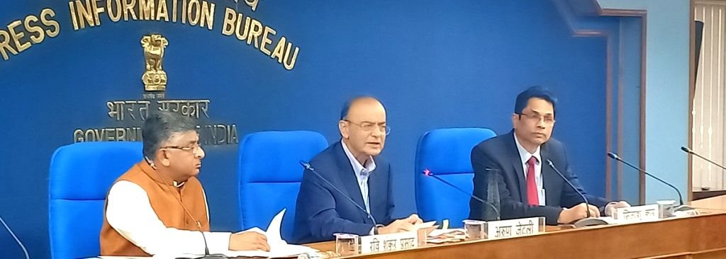 Union Finance and Corporate Affairs Minister Arun Jaitley along with Union Law and Justice Minister Ravi Shankar Prasada addresses a press conference in New Delhi, on March 7, 2019. - Arun Jaitley