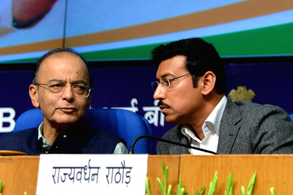 Union Finance and Corporate Affairs Minister Arun Jaitley and Union MoS Information and Broadcasting Rajyavardhan Singh Rathore at the release of the book 'Sabka Saath Sabka Vikas' ... - Arun Jaitley, Narendra Modi and Rajyavardhan Singh Rathore