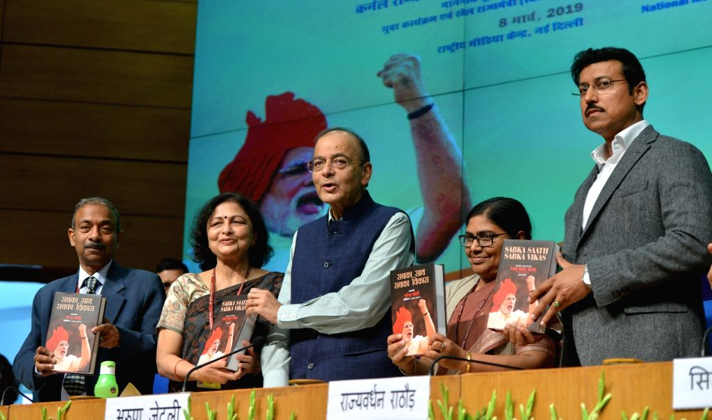 Union Finance and Corporate Affairs Minister Arun Jaitley along with Union MoS Information and Broadcasting Rajyavardhan Singh Rathore releases the book 'Sabka Saath Sabka Vikas' ... - Arun Jaitley, Narendra Modi and Rajyavardhan Singh Rathore