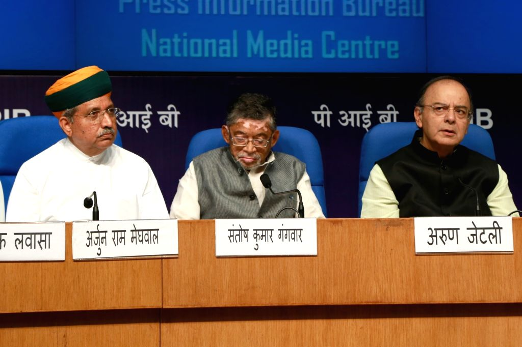 Union Finance Minister Arun Jaitley addressing a press conference on three years achievements in New Delhi on June 1, 2017  along with Santosh Gangwar and Arjun Ram Meghwal, Ministers of ... - Arun Jaitley