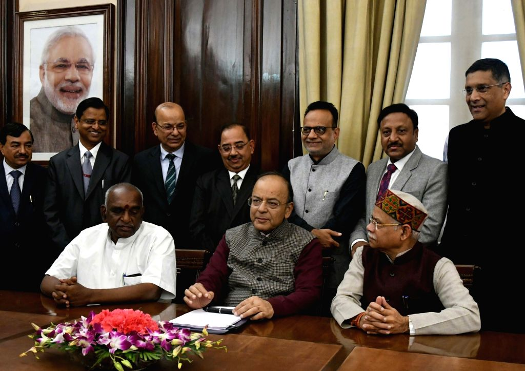 Union Finance Minister Arun Jaitley alongwith his collegues and Ministry official giving final touches to finance Budget papers at the North Block in New Delhi on Jan 31, 2018. - Arun Jaitley