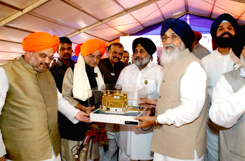 Union Finance Minister Arun Jaitley and Punjab Deputy Chief Minister Sukhbir Singh Badal with BJP chief Amit Shah during a during semi-centennial celebrations of Punjabi Suba in Amritsar, ... - Arun Jaitley, Sukhbir Singh Badal and Amit Shah