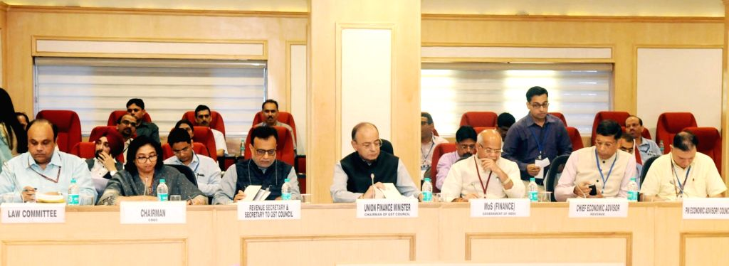 Union Finance Minister Arun Jaitley chairing the 22nd GST Council meeting, in New Delhi on Oct. 6, 2017. The Minister of State for Finance, Shiv Pratap Shukla, Revenue Secretary, Hasmukh ... - Arun Jaitley