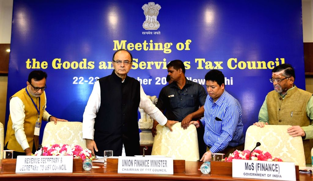 Union Finance Minister Arun Jaitley during the first meeting of the GST Council in New Delhi on Sept 22, 2016. Also seen Minister of State for Finance Santosh Gangwar and Revenue Secretary ... - Arun Jaitley