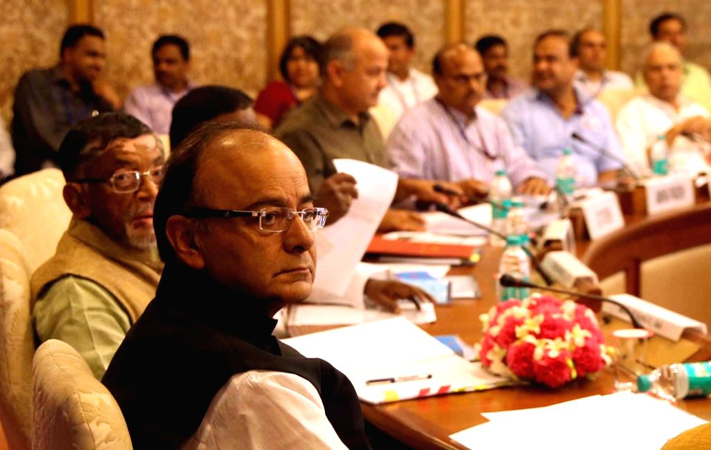 Union Finance Minister Arun Jaitley during the first meeting of the GST Council in New Delhi on Sept 22, 2016. Also seen Minister of State for Finance Santosh Gangwar and Delhi Deputy ... - Arun Jaitley