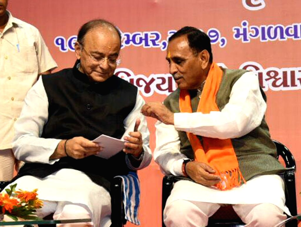 Union Finance Minister Arun Jaitley interacts with Gujarat Chief Minister Vijay Rupani during BJP working committee meeting in Ahmedabad on Sept 19, 2017. - Arun Jaitley