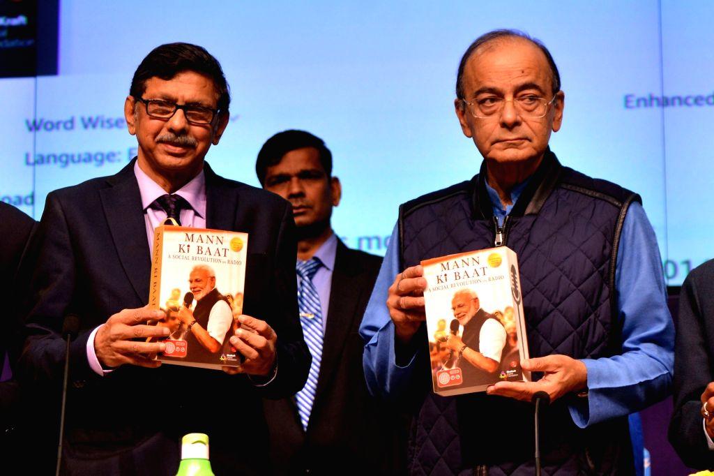 "Union Finance Minister Arun Jaitley with Prasar Bharati Chairman Dr. A. Surya Prakash at the release of the book ""Mann ki Baat - A Social Revolution on Radio"", in New Delhi on ... - Arun Jaitley"