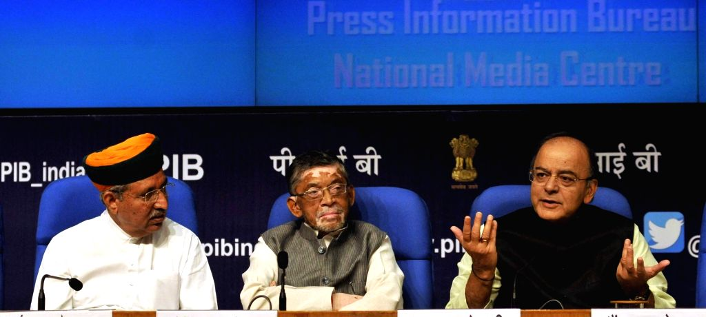 Union Finance Minister Arun Jaitley with Union MoS Finance Arjun Ram Meghwal and Santosh Gangwar during a press conference in New Delhi on June 1, 2017. - Arun Jaitley