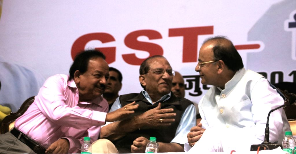 Union Finance Minister Arun Jaitley with Union Science and Technology Minister Harsh Vardhan and BJP leader Vijay Kumar Malhotra during GST-Delhi Sambodhan at Talkatora Stadium in New ... - Arun Jaitley and Vijay Kumar Malhotra