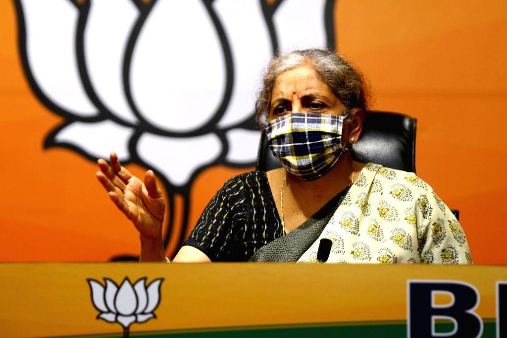 Union Finance Minister Nirmala Sitharaman addresses a press conference, at BJP HQ in New Delhi on October 25,2020. - Nirmala Sitharaman