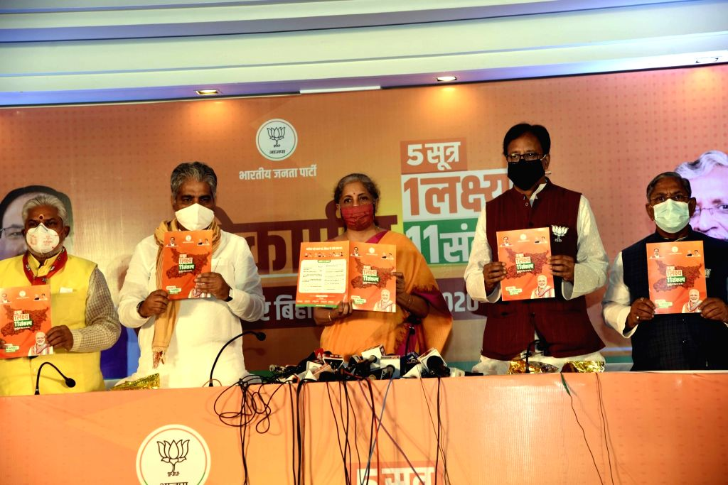 Union Finance Minister Nirmala Sitharaman, BJP Bihar In-charge Bhupendra Yadav and state party president Sanjay Jaiswal release the party election manifesto ahead of Bihar Assembly polls, in ... - Nirmala Sitharaman and Bhupendra Yadav