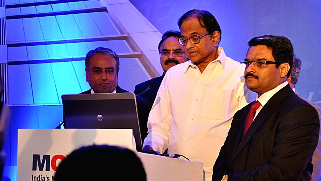 Union Finance Minister P Chidambarm ringing the bell to declare open the MCS-SX stock exchange in Mumbai on Feb. 9.