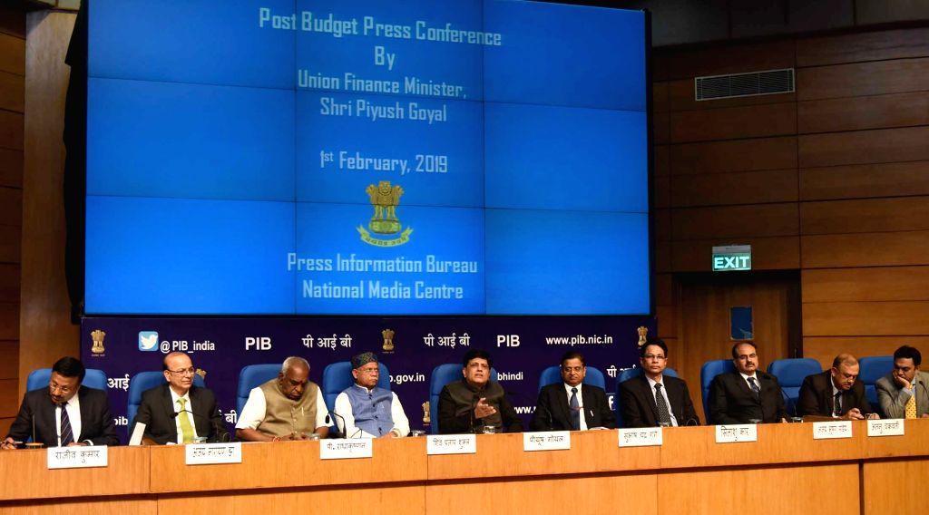 Union Finance Minister Piyush Goyal addresses a press conference in New Delhi, on Feb 1, 2019. Also seen Union Ministers of State for Finance Pon Radhakrishnan and Shiv Pratap Shukla, ... - Piyush Goyal