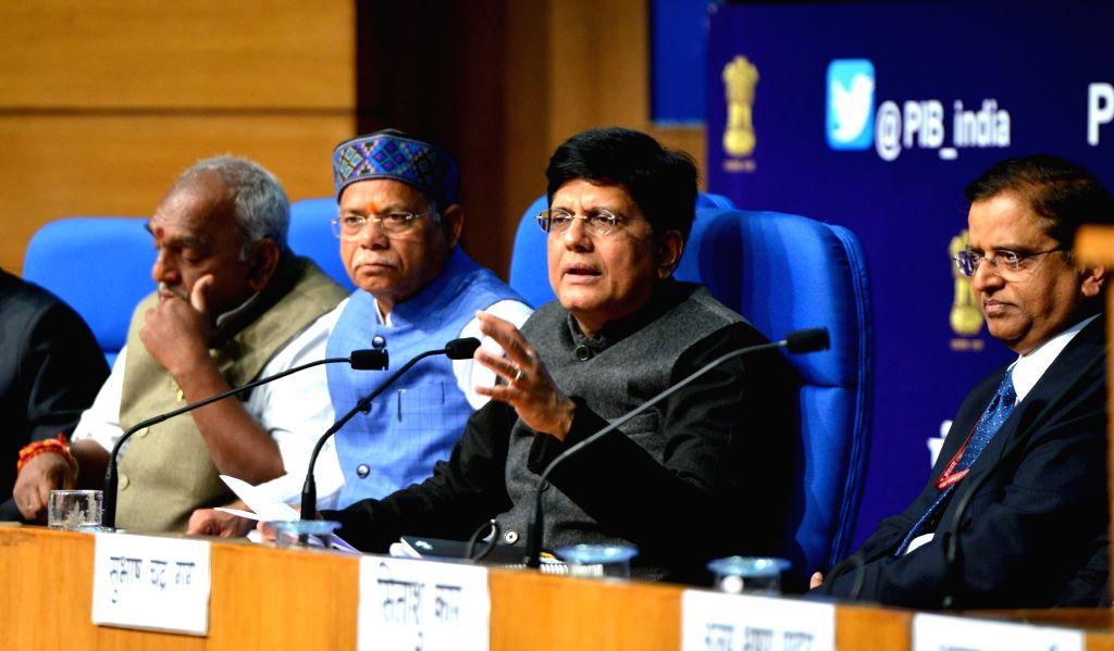Union Finance Minister Piyush Goyal along with Union Ministers of State for Finance Pon Radhakrishnan, Shiv Pratap Shukla and Economic Affairs Secretary Subhash Chandra Garg, addresses a ... - Piyush Goyal
