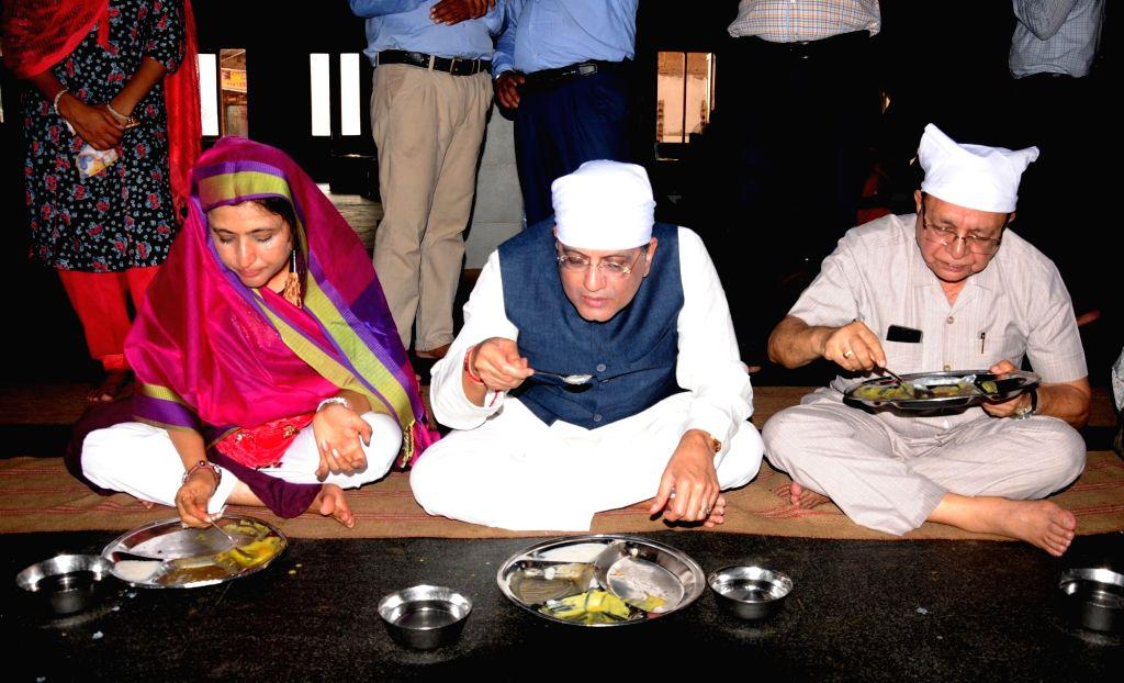 Union Finance Minister Piyush Goyal has 'Guru Ka Langar' along with his wife Seema Goyal, during their visit to the Golden Temple, in Amritsar on July 8, 2018. - Piyush Goyal
