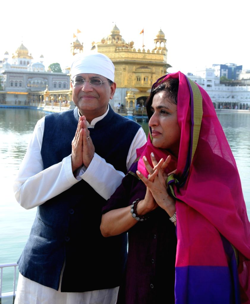 Union Finance Minister Piyush Goyal pays obeisance at the Golden Temple along with his wife Seema Goyal, in Amritsar on July 8, 2018. - Piyush Goyal