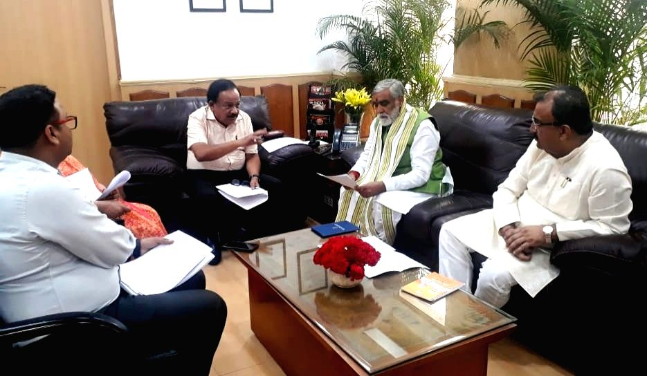 Union Health and Family Welfare Minister Harsh Vardhan holds a meeting with MoS Health and Family Welfare Ashwini Kumar Choubey and Bihar Health Minister Mangal Pandey over the death of more ... - Harsh Vardhan and Mangal Pandey