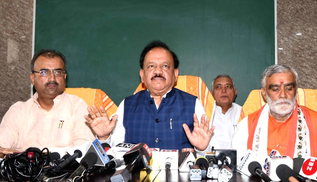 Union Health and Family Welfare Minister Harsh Vardhan accompanied by Union MoS Health and Family Welfare Ashwini Kumar Choubey, addresses a press conference after visiting children with ... - Harsh Vardhan