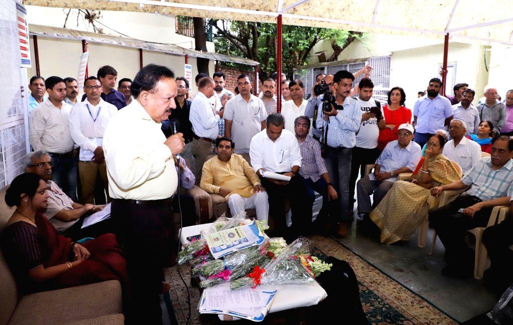 Union Health and Family Welfare Minister Harsh Vardhan addresses the RWA members of SFS colony, Hauz Khas during the special ???Jan Jagrukta Abhiyaan??? for community mobilisation and ... - Harsh Vardhan