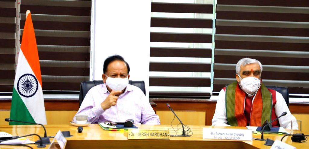 Union Health Minister Harsh Vardhan chairs a virtual meeting on the occasion of the World Population Day-2020, in New Delhi on July 11, 2020. Also seen Union MoS Health and Family Welfare ... - Harsh Vardhan