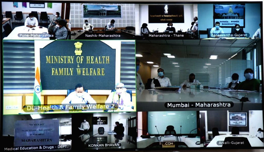 Union Health Minister Harsh Vardhan chairs a high-level review meeting on COVID-19 with Maharashtra Health Minister Rajesh Tope through video conferencing in New Delhi during the extended ... - Harsh Vardhan
