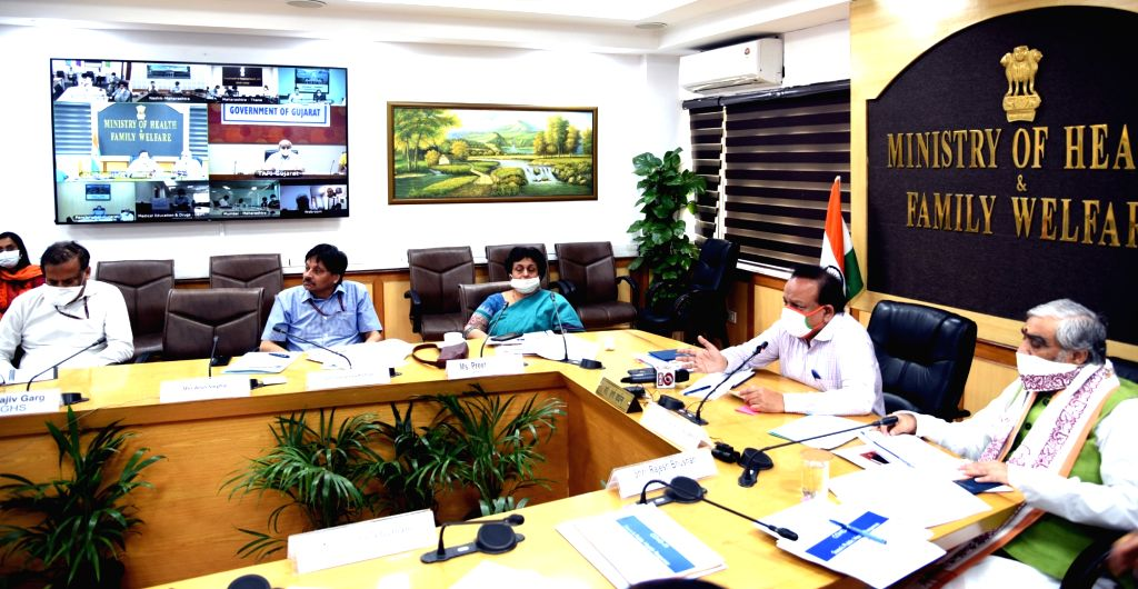 Union Health Minister Harsh Vardhan chairs a high-level review meeting on COVID-19 with Gujarat Health Minister Nitinbhai Ratilal Patel through video conferencing in New Delhi during the ... - Harsh Vardhan and Nitinbhai Ratilal Patel
