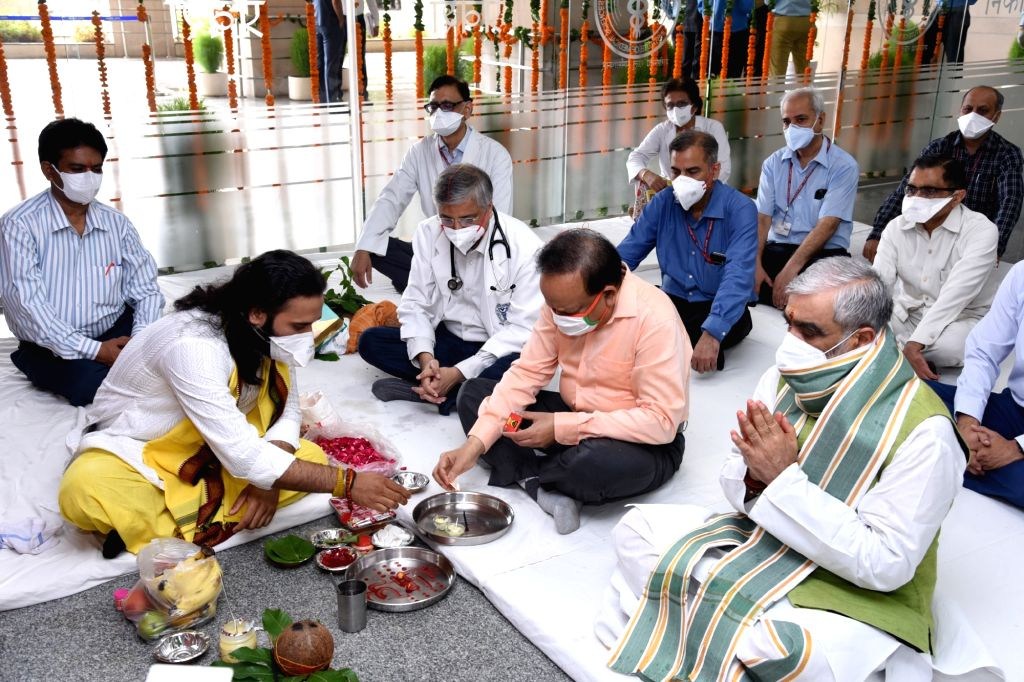 Union Health Minister Harsh Vardhan peforms rituals at a 'puja' during the inauguration of the Rajkumari Amrit Kaur OPD Block at AIIMS, Delhi on July 16, 2020. Also seen Union MoS Health ... - Harsh Vardhan