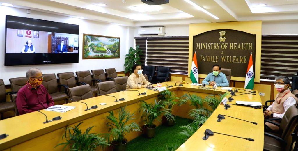 Union Health Minister Harsh Vardhan releases the 'Ayush Standard Treatment Protocol', via video conferencing, along with Union MoS AYUSH Sripad Yesso Naik and NITI Aayog Vice Chairman ... - Harsh Vardhan and Rajiv Kumar