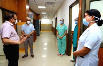 Union Health Minister Harsh Vardhan takes stock of preparedness of Covid-19 hospital at AIIMS Trauma Centre in New Delhi during the extended nationwide lockdown imposed to mitigate the ... - Harsh Vardhan