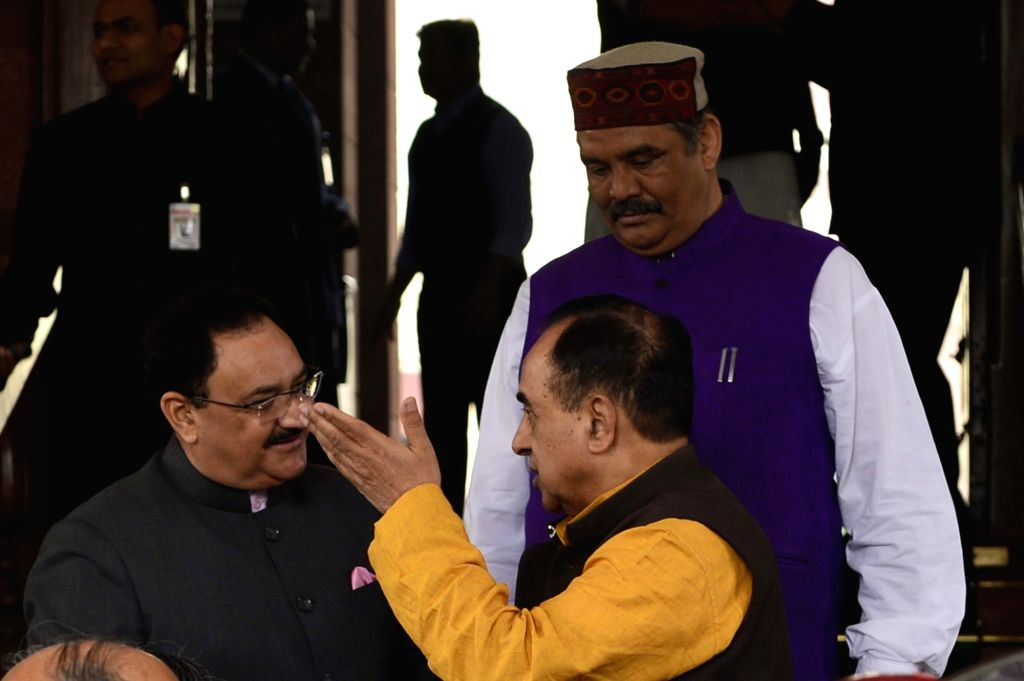 Union Health Minister JP Nadda and BJP leader Subramanian Swamy at the Parliament in New Delhi, on Dec 9, 2015. - J