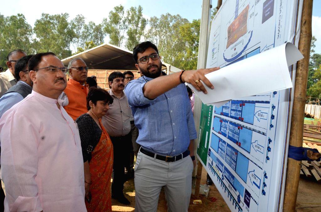 Union Health Minister JP Nadda inspects preparations for Prime Minister Narendra Modi's visit; in Ranchi on Sept 18, 2018. - J and Narendra Modi