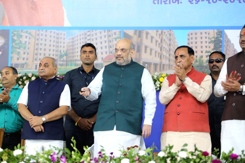 Union Home Minister Amit Shah accompanied by Gujarat Chief Minister Vijay Rupani and Deputy Chief Minister Nitinbhai Patel, at the foundation stone laying and inauguration of various ... - Amit Shah and Nitinbhai Patel