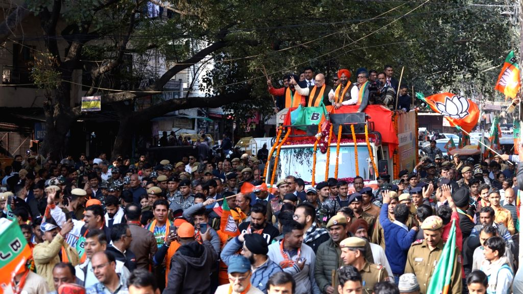 Union Home Minister Amit Shah accompanied by BJP's electoral candidate from Hari Nagar Tajinder Pal Singh Bagga, holds a roadshow ahead of February 8 Delhi Assembly elections, in New Delhi ... - Amit Shah