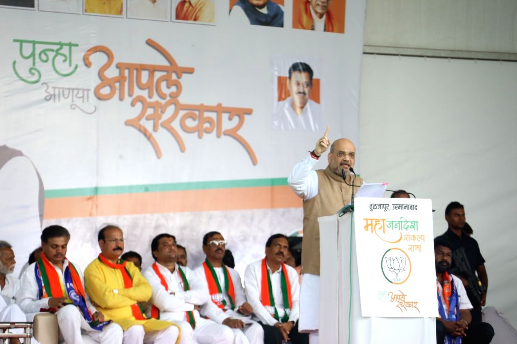 Union Home Minister Amit Shah addresses a public meeting at HUDCO Ground in Tuljapur, Maharashtra on Oct 10, 2019. - Amit Shah