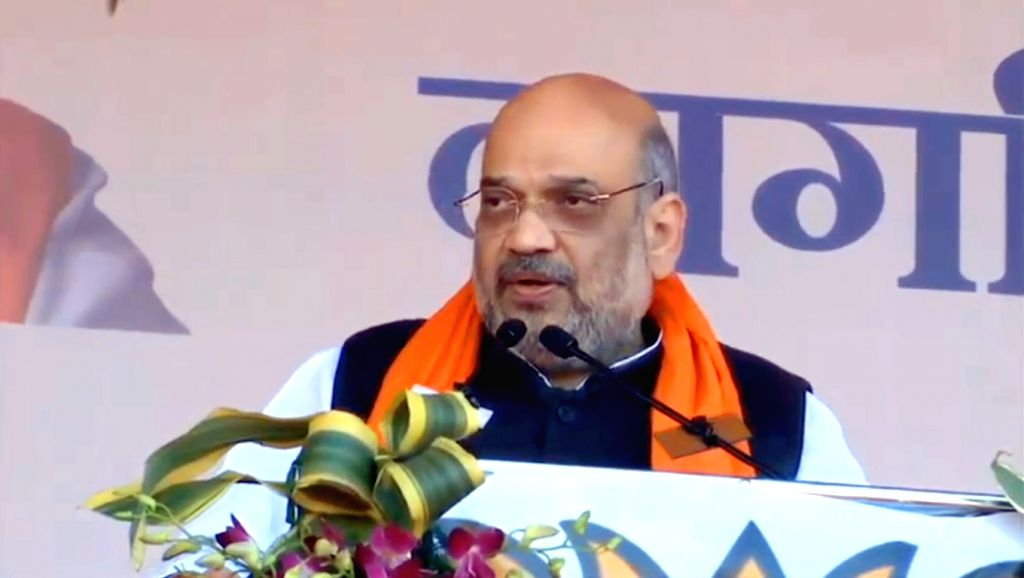 Union Home Minister Amit Shah addresses a rally as a part of the Bharatiya Janata Party's (BJP) campaign to create awareness about the Citizenship Amendment Act (CAA), at Garrison Ground in ... - Amit Shah