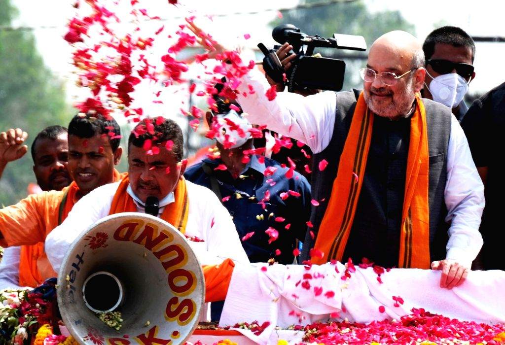 Union Home Minister Amit Shah alongwith Subhendu Adhikari candidate from Nandigram during a roadshow at the battle ground of Nandigram, Reyapara on Tuesday Monday March 30, 2021. - Amit Shah