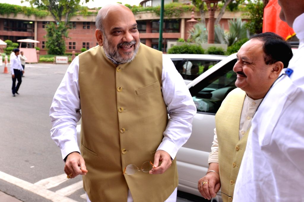 Union Home Minister Amit Shah and BJP MP J.P. Nadda arrive at Parliament, in New Delhi on July 25, 2019. - Amit Shah