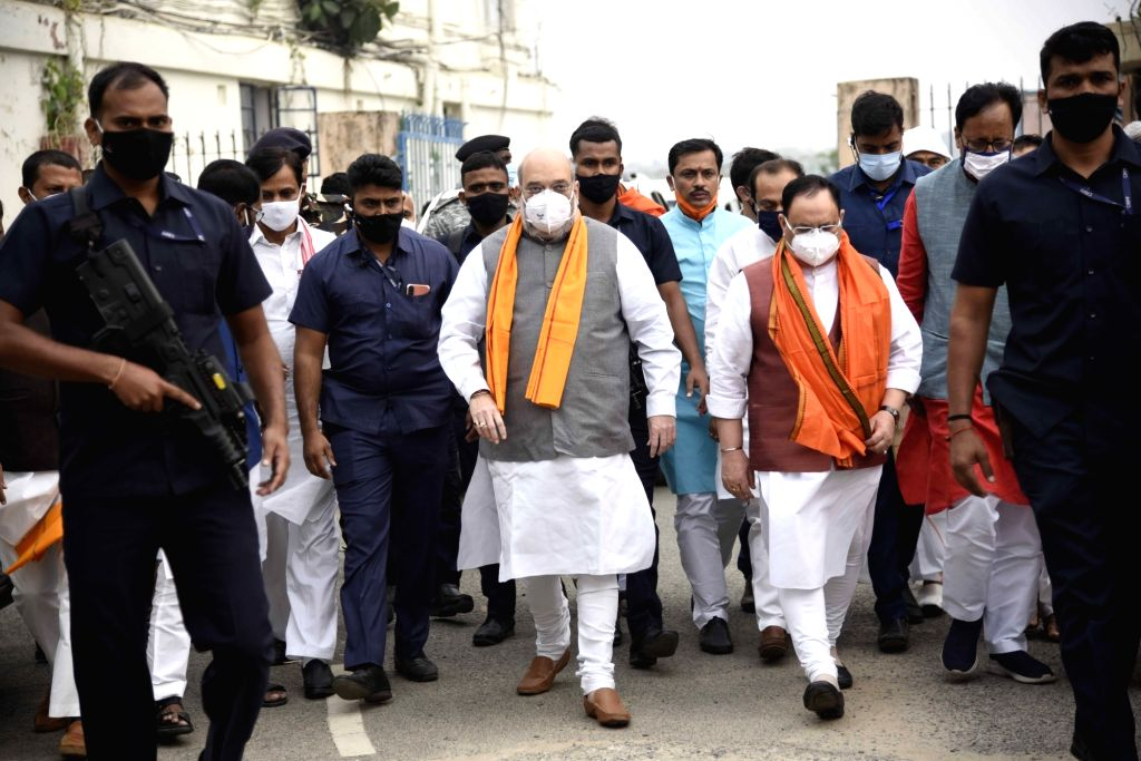 Union Home Minister Amit Shah and BJP National President JP Nadda arrive at Jaiprakash Narayan International Airport in Patna to attend the swearing-in-ceremony of Nitish Kumar, on Nov 16, ... - Amit Shah and Nitish Kumar